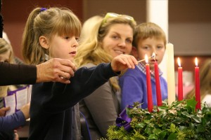 Children lighting candles