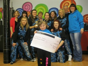 Six year old Morgan McGarry receives the Denstone Factor 2012 cheque for £500